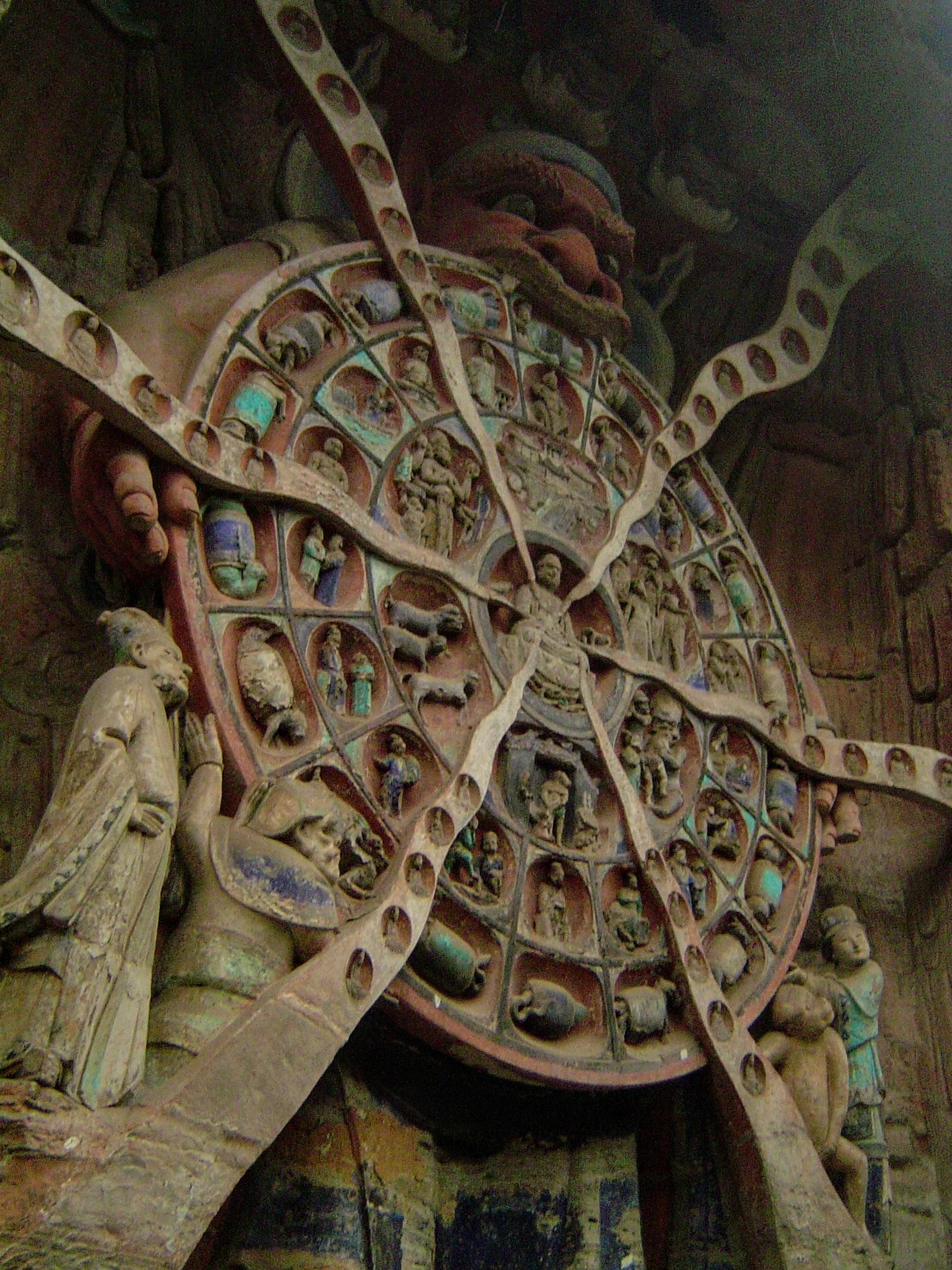 Mara étreignant la roue des réincarnations